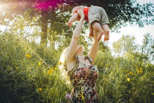 Canva - Woman Carrying Baby Near Grass
